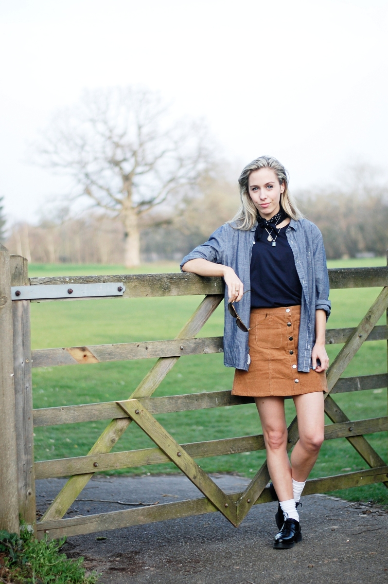 A blue mens shirt styled with a cord skirt