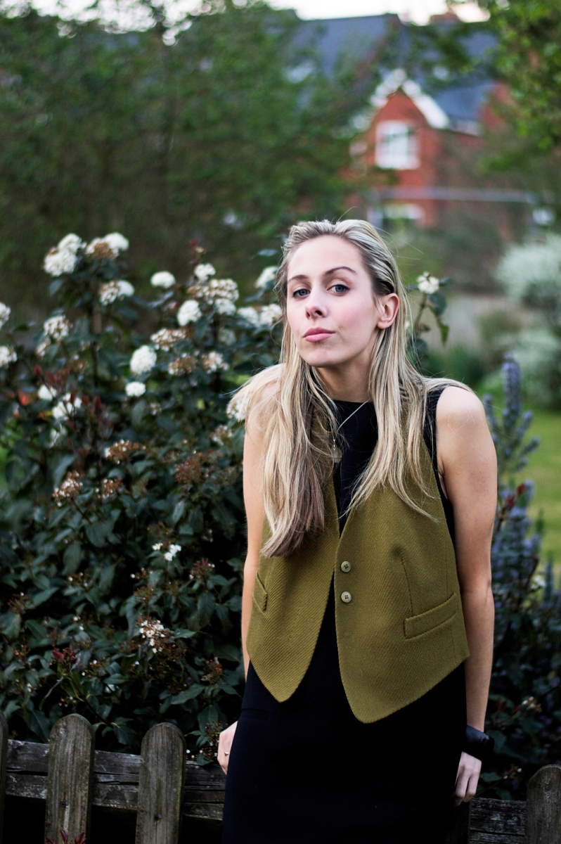 Styling an olive green waistcoat in a minimalist way.